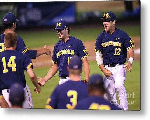 Working Metal Print featuring the photograph Michigan V Ucla - Game One by Jayne Kamin-oncea