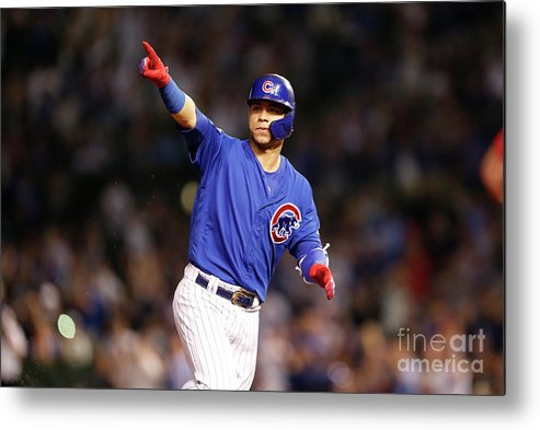 Following Metal Print featuring the photograph Atlanta Braves V Chicago Cubs by Nuccio Dinuzzo