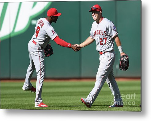 American League Baseball Metal Print featuring the photograph Justin Upton And Mike Trout by Thearon W. Henderson