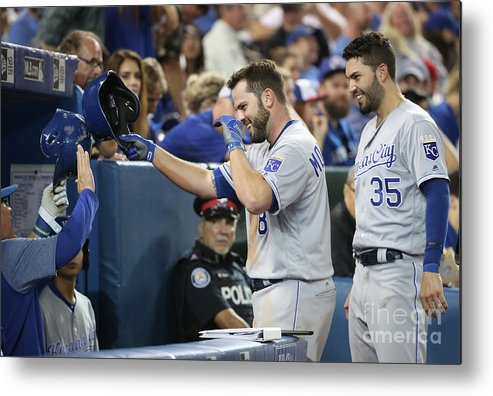 People Metal Print featuring the photograph Mike Moustakas, Eric Hosmer, And Ned Yost by Tom Szczerbowski