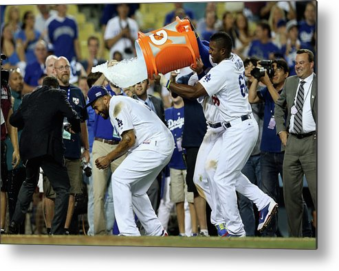 Game Two Metal Print featuring the photograph Yasiel Puig And Matt Kemp by Stephen Dunn