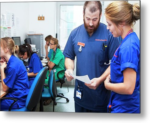 Small Group Of People Metal Print featuring the photograph A&e Nurses by Life In View