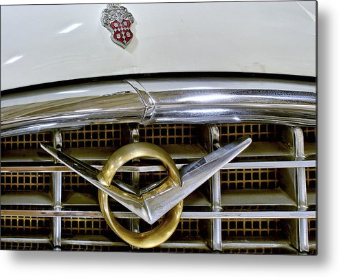 1956 Packard Metal Print featuring the photograph 1956 Packard Caribbean Headlight Grill by Michael Gordon