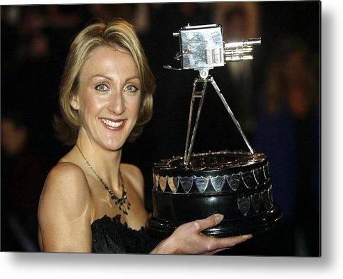 Bbc Television Centre Metal Print featuring the photograph Paula Radcliffe Poses With The Bbc Sports Personality Of The Year Award by Warren Little