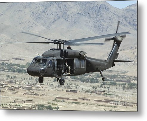 Horizontal Metal Print featuring the photograph A Uh-60 Blackhawk Helicopter by Stocktrek Images