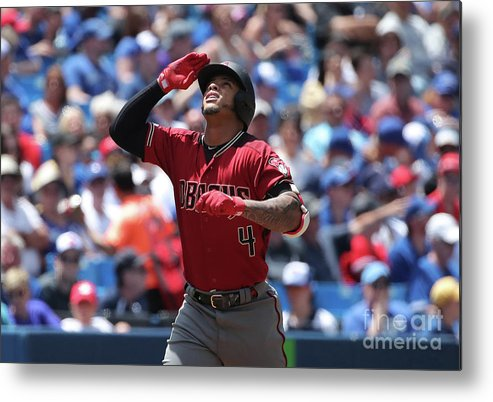 Three Quarter Length Metal Print featuring the photograph Arizona Diamondbacks V Toronto Blue Jays by Tom Szczerbowski