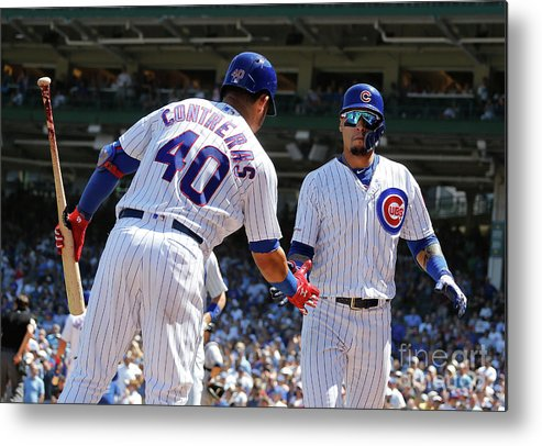 Following Metal Print featuring the photograph Milwaukee Brewers V Chicago Cubs 2 by Nuccio Dinuzzo