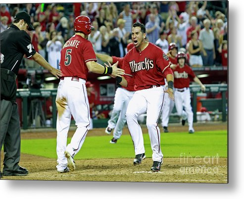 American League Baseball Metal Print featuring the photograph Ender Inciarte, David Peralta, And Paul Goldschmidt by Ralph Freso