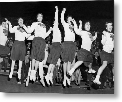 1950's Metal Print featuring the photograph Cheerleaders Jump For Joy by Underwood Archives