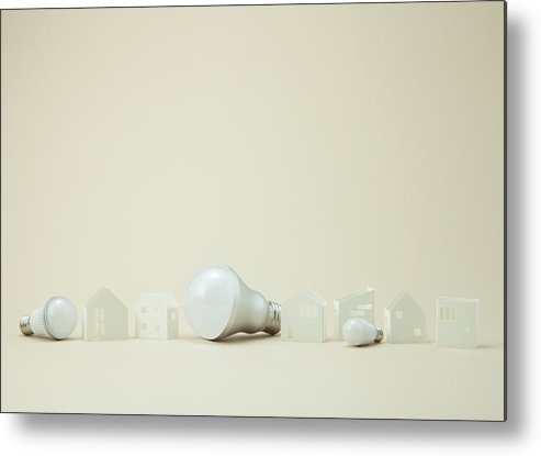 Horizontal Metal Print featuring the photograph Led Bulbs And Miniature Houses by sozaijiten/Datacraft