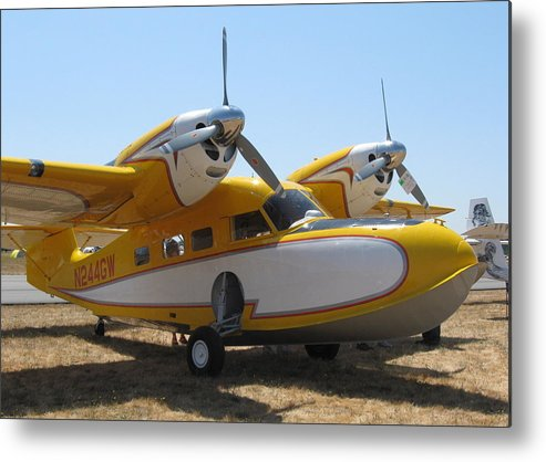 Airplane Metal Print featuring the photograph Yellow Goose by Thomas Sexton