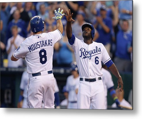 American League Baseball Metal Print featuring the photograph Mike Moustakas And Lorenzo Cain by Ed Zurga