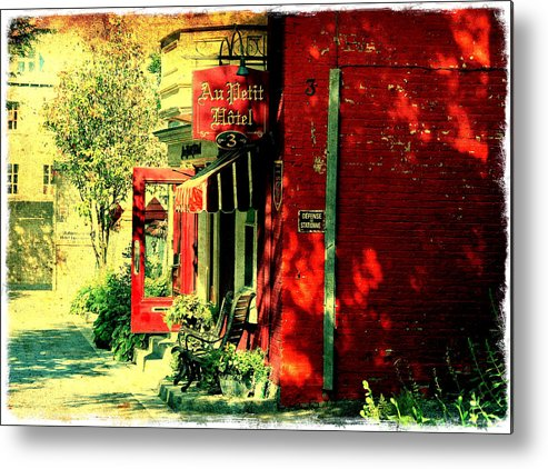 Red Brick Building Metal Print featuring the photograph Red Brick Hotel Photograph by Laura Carter