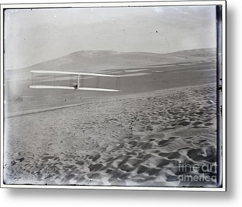 Orville Making Right Turn Metal Print featuring the photograph Orville Making Right Turn Showing Warping Of Wings Hill Visible In Front Of Him Kitty Hawk North Car by R Muirhead Art