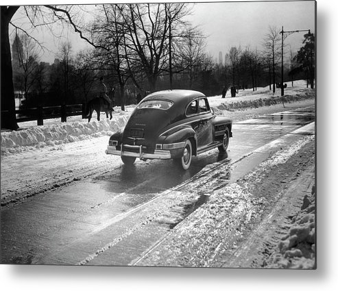 1950-1959 Metal Print featuring the photograph Car In The Snow by George Marks