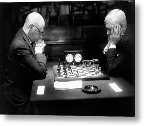 55-59 Years Metal Print featuring the photograph Mature Men Playing Chess, Profile (b&w) by Hulton Archive