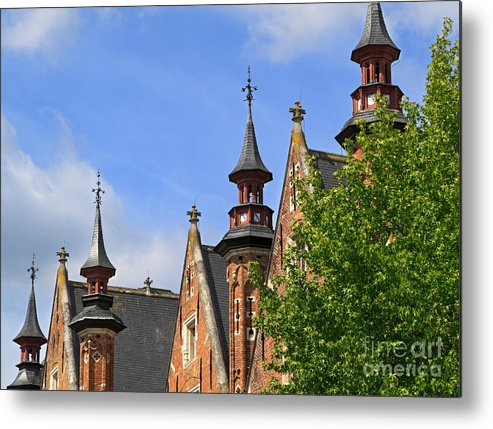 Steenhouwersdijk Metal Print featuring the photograph Turrets And Roofs Beside Steenhouwersdijk Canal In Bruges by Louise Heusinkveld
