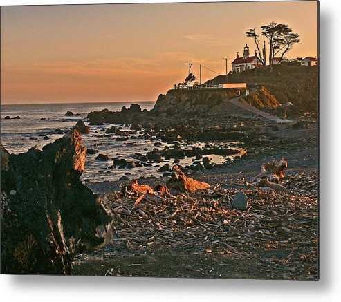 Lighthouse Sunset Metal Print featuring the photograph Lighthouse Sunset by Gracia Molloy