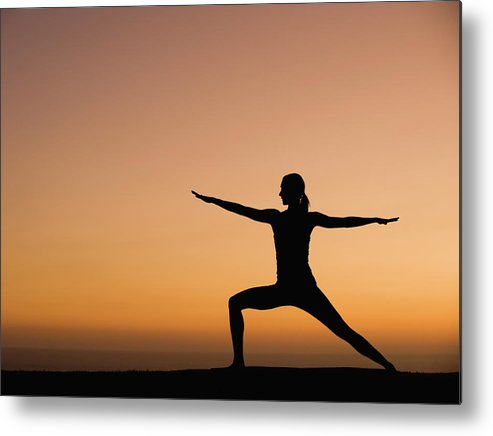 Tranquility Metal Print featuring the photograph Silhouette Of Woman Doing Yoga by Erik Isakson
