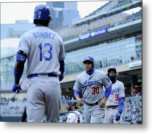 Second Inning Metal Print featuring the photograph Dee Gordon, Hanley Ramirez, And Miguel Olivo by Hannah Foslien