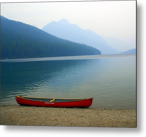 Glacier National Park Metal Print featuring the photograph Lonly Canoe by Marty Koch