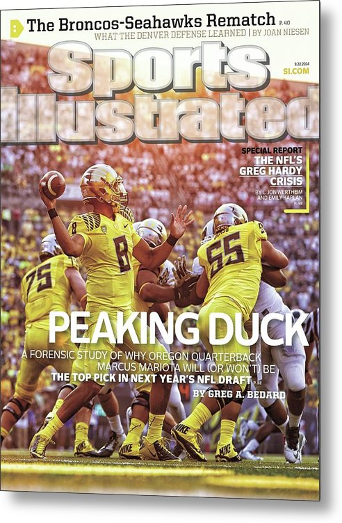 Michigan State University Metal Print featuring the photograph Peaking Duck Marcus Mariota Sports Illustrated Cover by Sports Illustrated