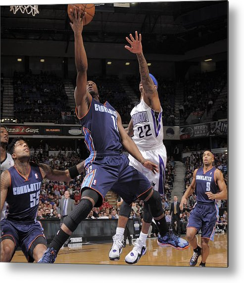 Kemba Walker Metal Print featuring the photograph Kemba Walker and Isaiah Thomas by Rocky Widner