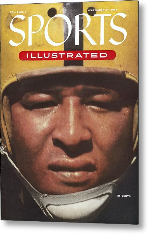 1950-1959 Metal Print featuring the photograph University Of Iowa Calvin Jones Sports Illustrated Cover by Sports Illustrated