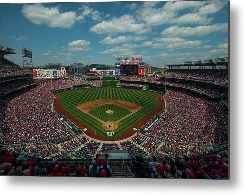 Motion Metal Print featuring the photograph Atlanta Braves V. Washington Nationals by Rob Tringali