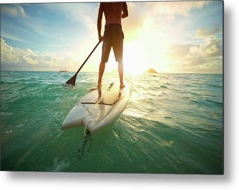 Tranquility Metal Print featuring the photograph Caucasian Man On Paddle Board In Ocean by Colin Anderson Productions Pty Ltd