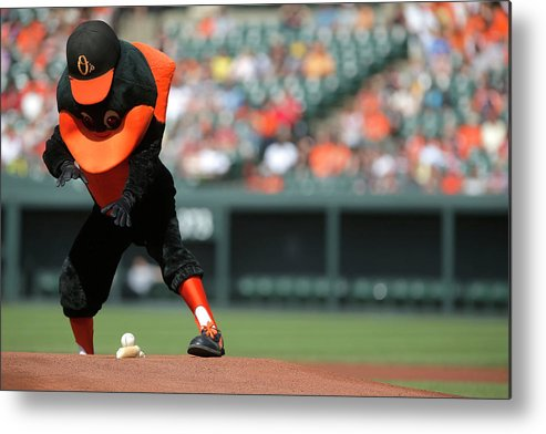 American League Baseball Metal Print featuring the photograph Toronto Blue Jays V Baltimore Orioles by Jonathan Ernst