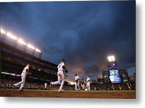 National League Baseball Metal Print featuring the photograph New York Mets V Colorado Rockies by Doug Pensinger