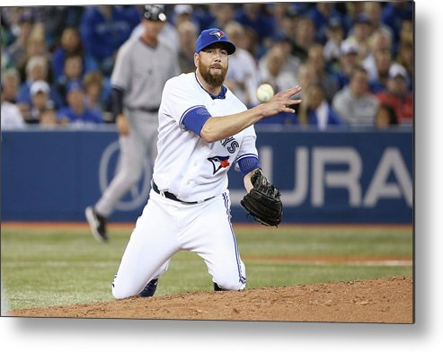 American League Baseball Metal Print featuring the photograph New York Yankees V Toronto Blue Jays by Tom Szczerbowski