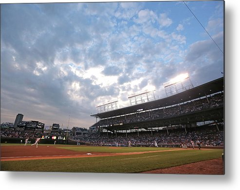 National League Baseball Metal Print featuring the photograph Cincinnati Reds V Chicago Cubs by Jonathan Daniel