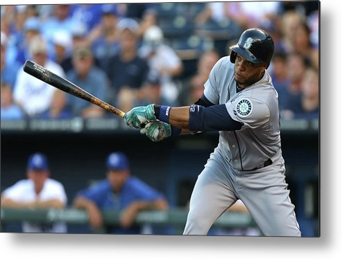 American League Baseball Metal Print featuring the photograph Seattle Mariners V Kansas City Royals by Ed Zurga