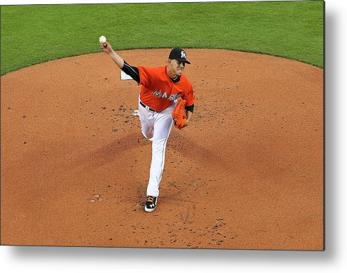 People Metal Print featuring the photograph Colorado Rockies V Miami Marlins by Mike Ehrmann
