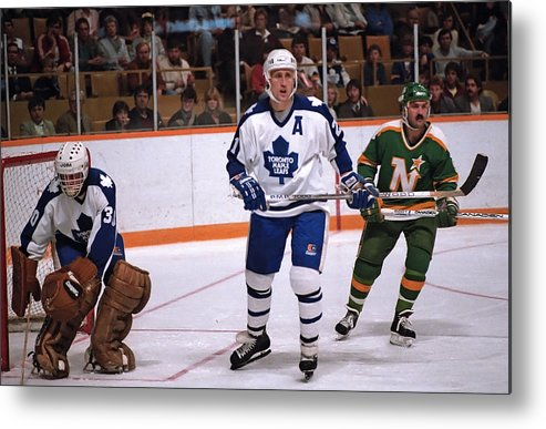 1980-1989 Metal Print featuring the photograph Minnesota North Stars v Toronto Maple Leafs by Graig Abel