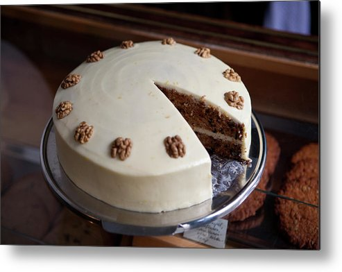 Unhealthy Eating Metal Print featuring the photograph A Carrot Cake On A Display Cabinet In A by Halfdark