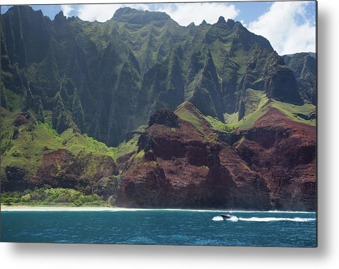 Tranquility Metal Print featuring the photograph A Catamaran Cruises Along The Napali by Matthew Micah Wright
