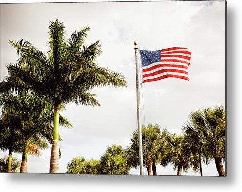 Tranquility Metal Print featuring the photograph American Flag Flying Amongst Palm Trees by Ron Levine