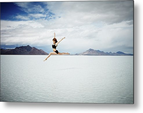 Ballet Dancer Metal Print featuring the photograph Ballerina Leaping In Mid-air Over Lake by Thomas Barwick