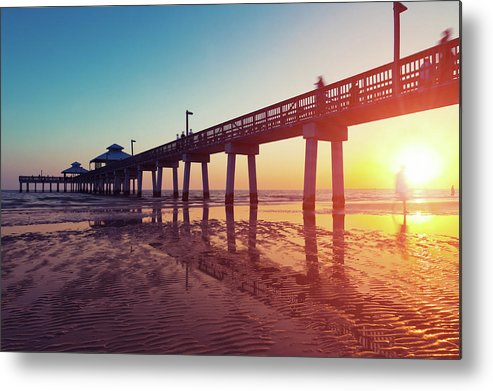 Water's Edge Metal Print featuring the photograph Boardwalk At Sunset While The Sun by Moreiso