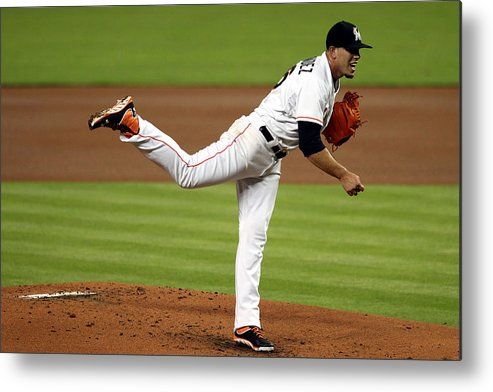 People Metal Print featuring the photograph Cleveland Indians V Miami Marlins by Marc Serota