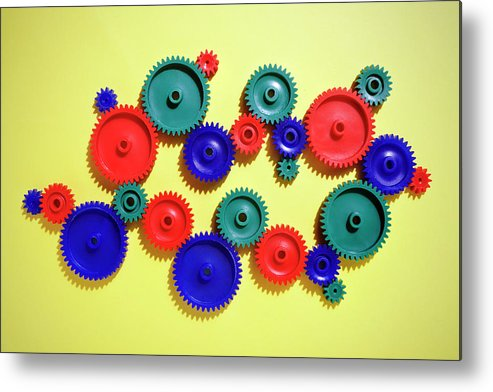 Working Metal Print featuring the photograph Colored Gears by Joseph Clark