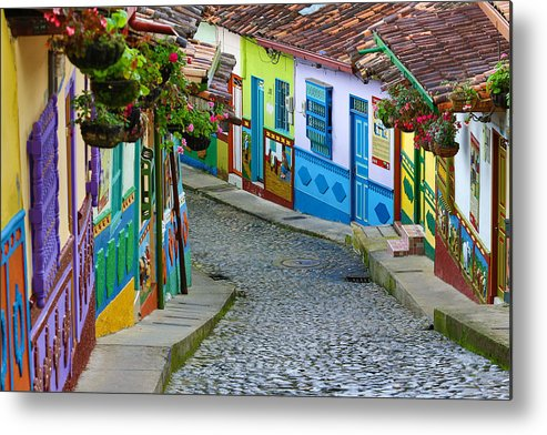 Built Structure Metal Print featuring the photograph colourful architecture in Guatape by Barna Tanko