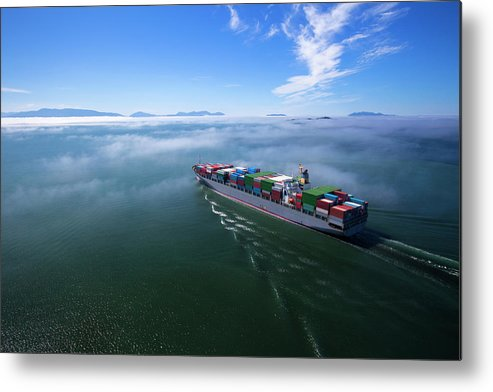Freight Transportation Metal Print featuring the photograph Container Ship by Dan prat