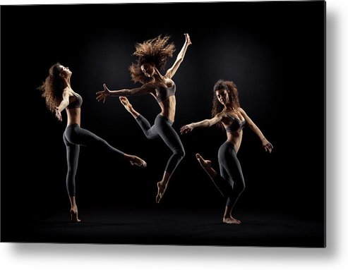 Human Arm Metal Print featuring the photograph Dancer Pose On Black Background by Zonecreative