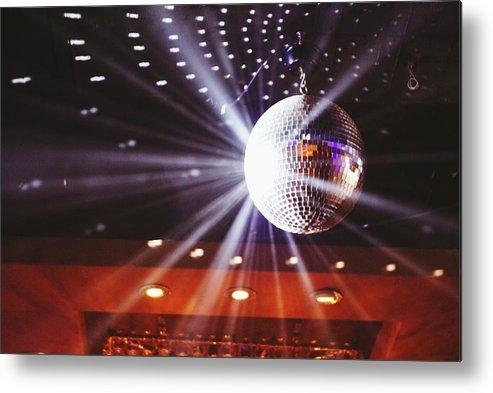 Hanging Metal Print featuring the photograph Disco Ball At Illuminated Nightclub by Shaun Wang / Eyeem