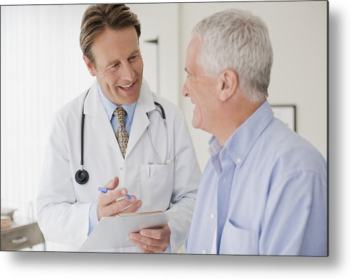 Expertise Metal Print featuring the photograph Doctor talking with patient in doctors office by Martin Barraud