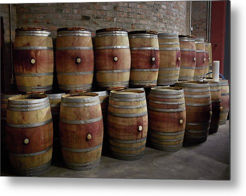 Stellenbosch Metal Print featuring the photograph French Wine Barrels Stacked At Winery by Klaus Vedfelt